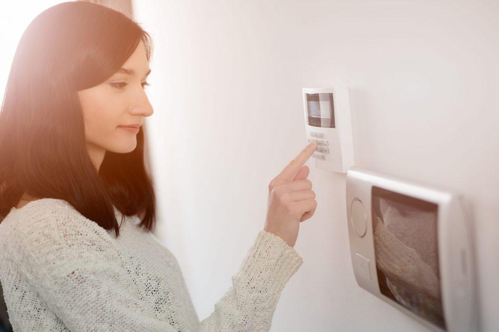 lady operating alarm system