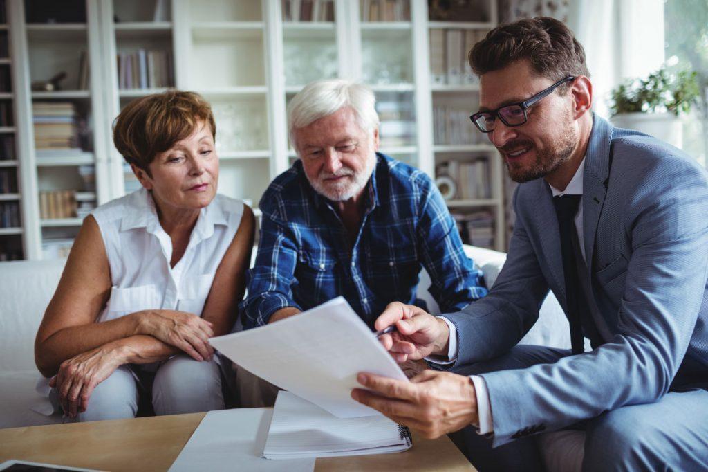 Man showing senior couple paperwork