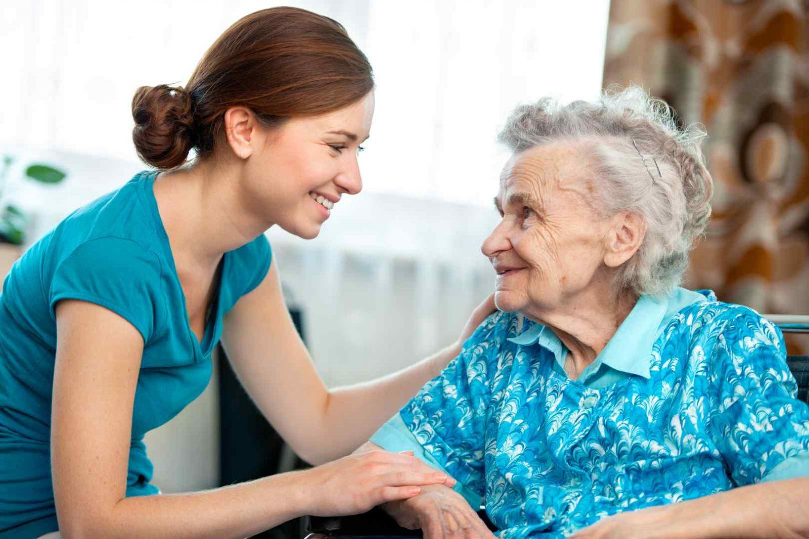 Young lady caring for elderly lady