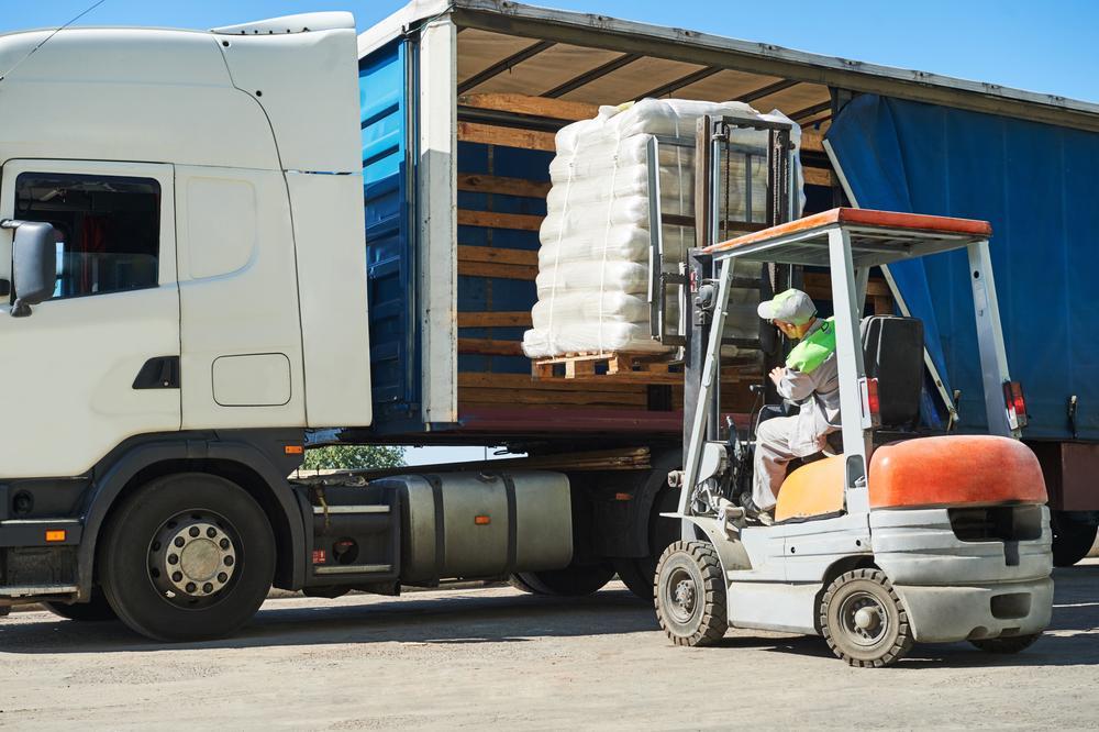 Man loading pallet onto truck