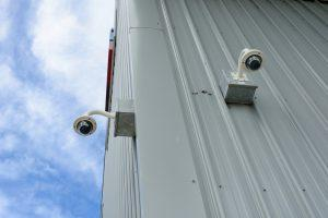 Two CCTV cameras on warehouse
