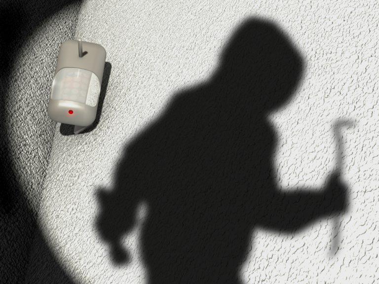 Shadow of burglar against a wall